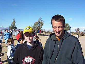 Hawk at the opening of the Needles Skate Park in Needles, California, in 2004. Hawk donated $10,000 to the building of the park and made an appearance at the grand opening. JasonTonyParkOpening.JPG