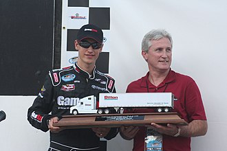 Joey Logano - Logano holds his trophy for winning the pole position in Nashville