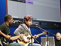 John Mayer with David Ryan Harris playing at the Macworld 2005 in San Francisco.