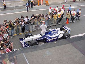 Williams FW24 - Juan Pablo Montoya exiting his FW24 after securing pole position for the 2002 Canadian Grand Prix