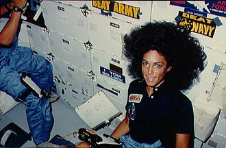 """Judith Resnik - Resnik on the middeck of Discovery during STS-41-D, with a """"I love Tom Selleck"""" sticker on her locker."""