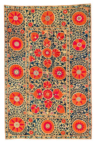 Suzani (textile) - Kermina Suzani, first half 19th century, Uzbekistan. The large blossoms in red, orange, salmon, a pale aubergine and light blue show the characteristic metallic sheen of Kermina embroideries.
