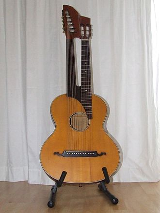 Multi-neck guitar - A 12-string acoustic contraguitar with fretted and fretless necks.