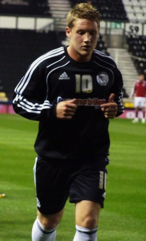 Kris Commons - Commons warming up for Derby.