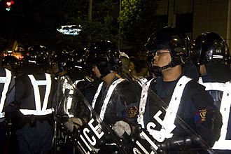 Crowd control - Kyoto Prefectural Riot Police Unit officers on duty during the Gion Matsuri 2008 festival.