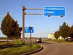 LAN Airport - East Circle Dr - Arrivals Departures Parking Sign.jpg
