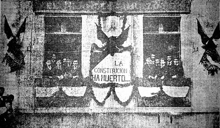 "A banner (1903) at the office of opposition magazine El hijo de Ahuizote reads: ""The Constitution has died..."" (La Constitucion ha muerto...) La Constitucion ha muerto 1903.jpg"