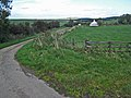 Lane, field and cottage, north of Girvan - geograph.org.uk - 262883.jpg