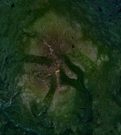 A massive open volcano situated on a plateau consisting of a series of buttes and ridges.