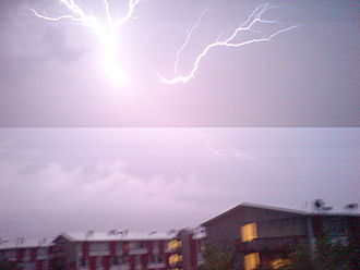 Focal-plane shutter - Two sections of the frame are exposed differently due to a lightning strike that occurred during the exposure. A similar effect occurs if electronic flash is used when the shutter is set faster than X-sync.