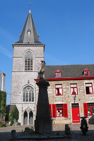 Limbourg  (Belgium), the church of Saint George (XVth century) and the Holy Virgin water pump (XVIIth century).
