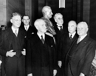 Lyman Duff - Sir Lyman Duff poses with his bust at its official unveiling, Sept. 5, 1947.  In photo: (L.-R.:) J.L. Ilsley, J.C. McRuer, Sir Lyman Duff, John T. Hackett, K.C., W.L. Mackenzie King, Thibaudeau Rinfret.
