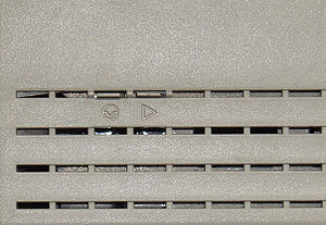 Macintosh Classic II - Image: Macintosh Classic II Left Side Reset Interrupt Switch