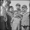 Manzanar Relocation Center, Manzanar, California. Group of little evacuees of Japanese descent at M . . . - NARA - 538544.tif