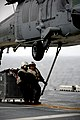 Marines connect cargo to an MH-60S. (8407483583).jpg