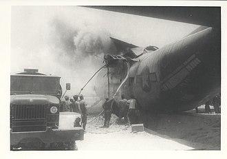 Quảng Trị Combat Base - Marines extinguish a burning C-130 at Quang Tri Combat Base, 24 May 1968