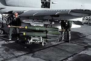 Crewmen upload three Mark 81 general purpose high explosive bombs, with Mark 14 TRD (Tail Retarding Device) attached, aboard an A-4F Skyhawk aircraft from Marine Attack Squadron 133 (VMA-133).
