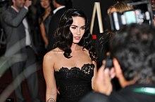Megan Fox wearing a strapless black dress