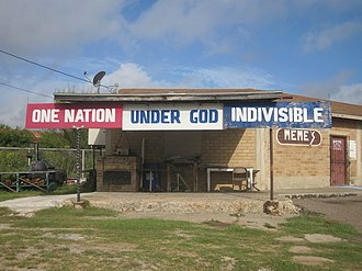 Asherton, Texas - Meme's Bar in Asherton recites a line from the Pledge of Allegiance to the American flag.
