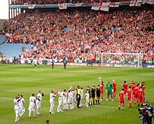 The Middlesbrough And West Ham United Teams Line Up Before Their Semi Final Match