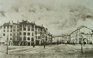 Coperto dei Figini - Piazza del Duomo circa 1860, in a photograph by Alessandro Duroni (1807-1870). The Coperto dei Figini is the building on the far right. On the left, the ancient neighborhood of the Rebecchino, demolished in the same years as the Coperto.