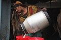 Milkmaid collects milk in a dairy farm, Sirajganj.jpg