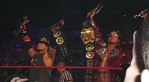 John Morrison and The Miz - The Miz (left) and Morrison (right) with the World Tag Team Championship and Slammy Awards.