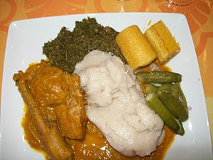 Angolan cuisine - Moamba de galinha, traditional dish of Luanda - palm oil, cassava flour porridge, okra, plantains, wild spinach