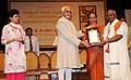 Mohd. Hamid Ansari presenting the Sangeet Natak Akademi Award-2010 to Shri Srimushnam Venkataramana Rajarao, Tamil Nadu, for his outstanding contribution to Carnatic Instrumental Music (Mridangam).jpg