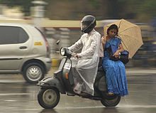 Monsoon couple on motorcycle.jpg