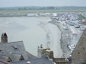 Couesnon - The causeway connecting Mont Saint-Michel to the mainland, responsible for the massive buildup of mud and sediment in the area.