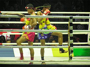 Two young Muay Thai fighters doing the pre-match ritual dance, called Wai Kru.