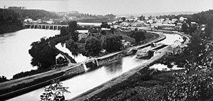 Rexford, New York - This photo shows the earlier years of the Erie Canal as its stone aqueduct passes over the Mohawk River through Rexford.