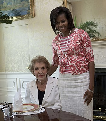 First Lady Michelle Obama visits with Former F...