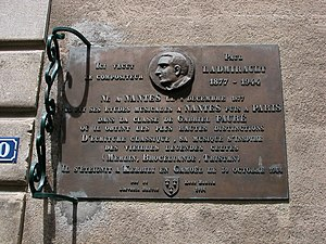 """Paul Ladmirault - A plaque commemorating Ladmirault at his home in Nantes. It states, """"he studied music in Nantes then at Paris under Gabriel Fauré, where he achieved the highest distinction. His music was inspired by classical literature and ancient Celtic legend (Merlin, Brocéliande, Tristan)."""""""