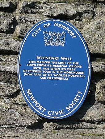 Plaque on eastern wall surrounding the cathedral marking the boundary of the mediaeval borough Newport boundary wall.jpg