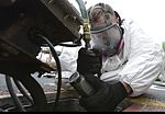 Nimitz Sailor performs flight deck maintenance 151123-N-ZZ999-004.jpg