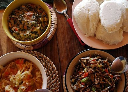 Nshima (top right corner) with three types of relish. Nsima Relishes.JPG