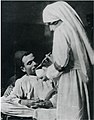 Nurse providing a meal to a wounded Ottoman soldier (cropped).jpg