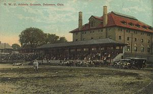 Ohio Wesleyan University - An early baseball game at Edwards Field, with Edwards Gymnasium in the background.