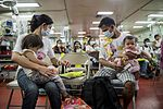 Operation Smile patients board USNS Mercy during Pacific Partnership 2015 150808-F-YW474-123.jpg