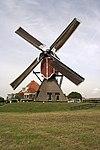 oud-ade - rode molen met zeilen