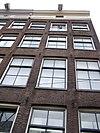 foto van Hoekhuis met gevel waarvan de rechte lijst met consoles
