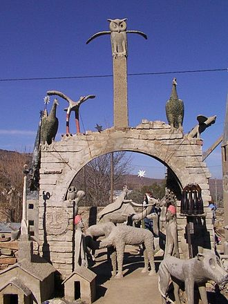 The Owl House - A large arch with an owl at the peak.