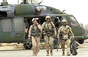 United States Air Force Pararescue - Pararescuemen with the 301st Rescue Squadron return with a downed pilot from a successful rescue mission 8 April 2003 at a forward deployed location in southern Iraq during Operation Iraqi Freedom.