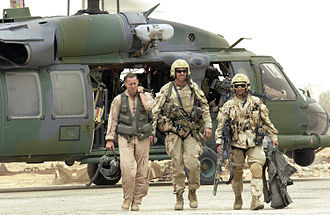 Combat search and rescue - Pararescuemen return with a downed pilot from a successful rescue mission in southern Iraq (2003).