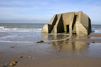 Wissant - The sea encroaches upon a World War II concrete blockhouse at Wissant