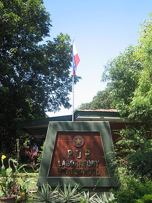 Polytechnic University of the Philippines Laboratory High School - The front of PUP Laboratory High School with the Philippine Flag in the foreground