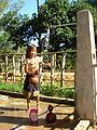 Pakoh girl fills water gourds.jpg