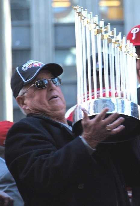 Pat Gillick holds up 2008 WS trophy CROP